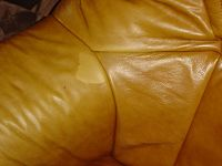 3-seater leather sofa worn and torn